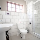The twin bed chalets have very neat tiled bathrooms with showers.