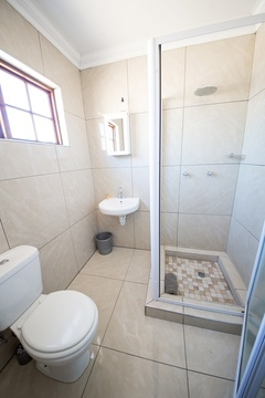 The double rooms have neatly tiled en suite bathrooms with a shower.