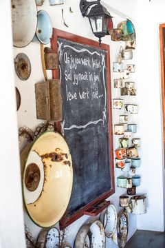 "Enamel collage on the stoep of the breakfast room with owner AP du Toit's quote: ""If you love what you are doing, you will never work a day in your life!"" Very true words Ap:)"