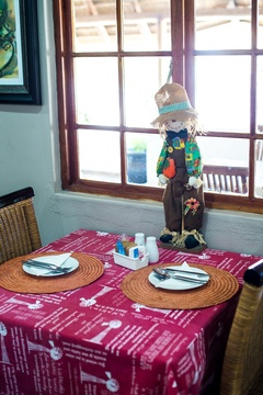 "Scarecrows and ""windpompe"" in the breakfast room."